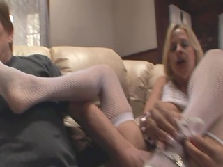 blondes giving a perverted footjob in stockings