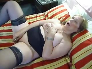 older plump dildoing on sofa