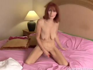 slender older dilettante redhead undresses off