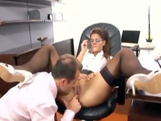 Secretary with glasses having sex in stockings