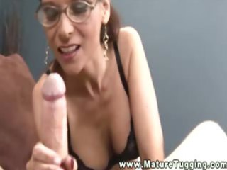 hot breasty mature with glasses jacking pecker