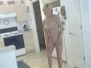 older hot mommy in natures garb in kitchen