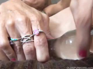 aged redhead bonks her pussy and butthole