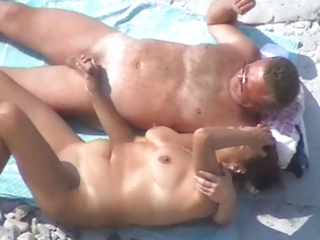 Another nice mature couple on the beach