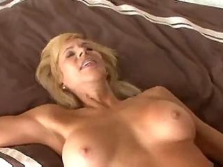 breasty older cougar seduces a younger lad