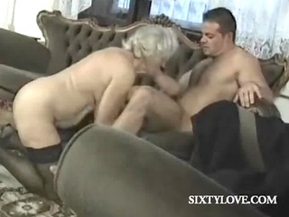 Mature blonde bitch rides cock in group sex