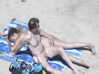 sexually lustful wife with big bumpers on beach