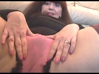 Busty mature with hairy pussy teases