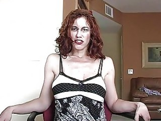 aroused redhead momma with glasses acquires her