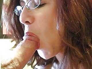 redhead momma with huge boobs and glasses gives