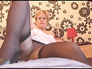 Busty mature babe in pantyhose stockings and slip