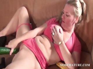 bawdy mature bonks cum-hole with a cucumber