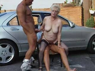 granny in nylons plays with two rods