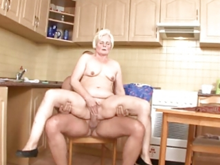 mamma serves up pussy in the kitchen
