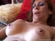 glamorous older redhead is feeling slutty