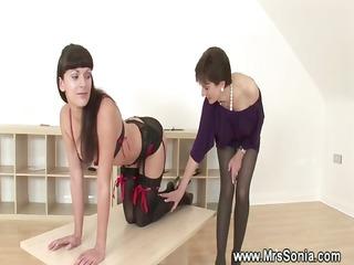 dominatrix spanking a perverted honey