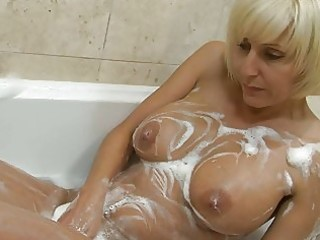 playful blonde mother i with large bosom plays