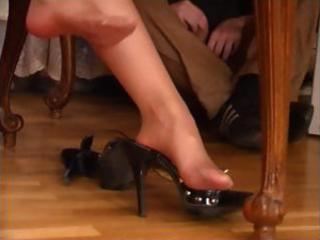 brunette milf in hose gets her feet worshiped by
