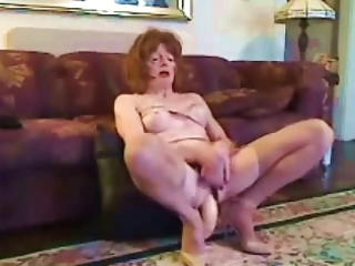 older cd takes a huge vibrator in her wazoo