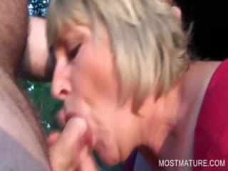 outdoor oral pleasure with golden-haired older