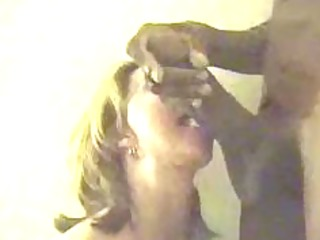 Mature woman deepthroats massive black cock