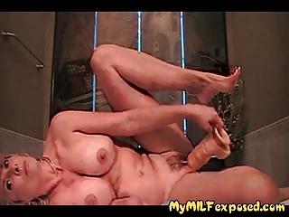 Busty amateur milf playing with huge rubber dildo