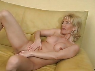aged golden-haired plays with herself