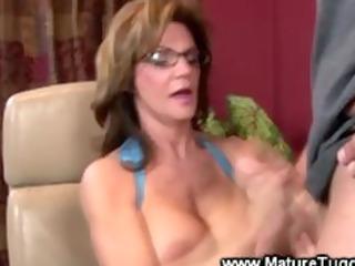 Mature lady massaging a cock
