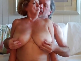 large boobed older woman rides her spouse 5