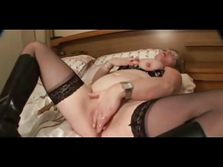 large nippled granny in stockings undresses and