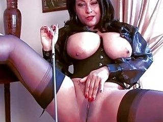 Arousing brunette momma in corset and stockings