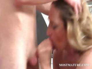 golden-haired mom takes dong in throat and