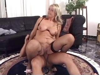 Mature blonde with big tits goes deep and then