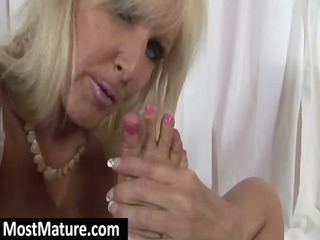 older licking her own toes and feet