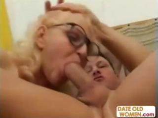 blond grandmother face holes a younger cock and
