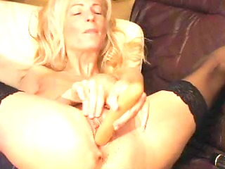 aged blond plays with big toy