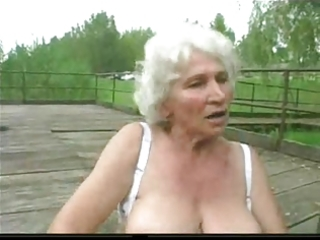 Granny norma outdoors with big toys and a suck to