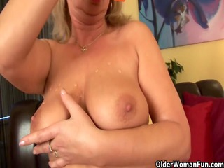 buxom granny gives her old vagina a treat
