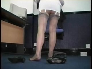 Mature secretary teases in corsets and stockings