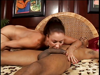 Exotic milf sucks massive black cock as well as