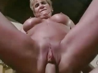 mature babe jizzed on massive fake tits