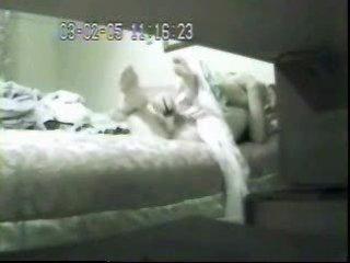 mummy masturbating in bed. hidden web camera