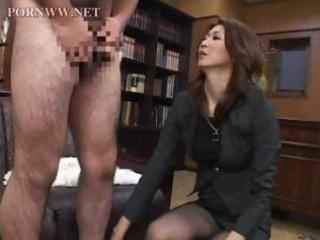 oriental older sits on his face in the office and