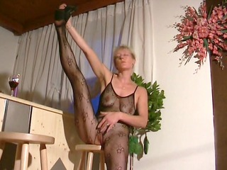 golden-haired mom shows off in hose outfit -