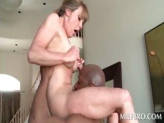 golden-haired older mama fucks darksome pecker